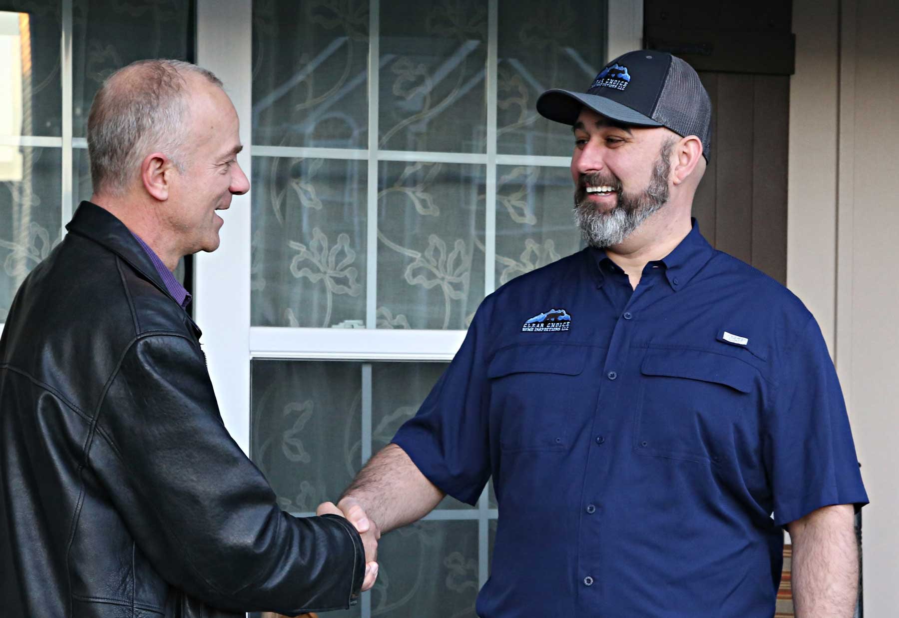 Clear Choice Owner, Josh Rose shaking hands with clients