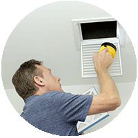 Man checking air filter air quality inspection h9ome health check