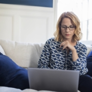 woman looking at her laptop | American Verified Home Inspection | protecting your digital house from cybercrime